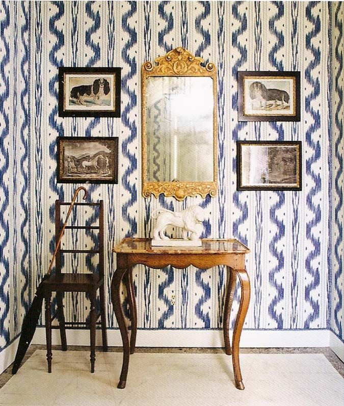 This is one of my favorite patterns from Pierre Frey...and don't be afraid to make holes in your wallpaper, the art work makes the paper pop out even more. tiltonfenwick.com